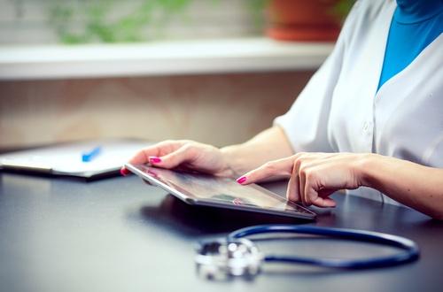 QAPI doctor using tablet