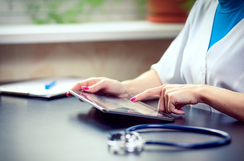 QAPI doctor using tablet