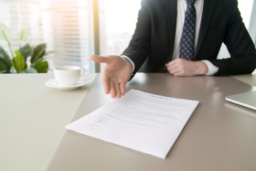 hand pointing at contract