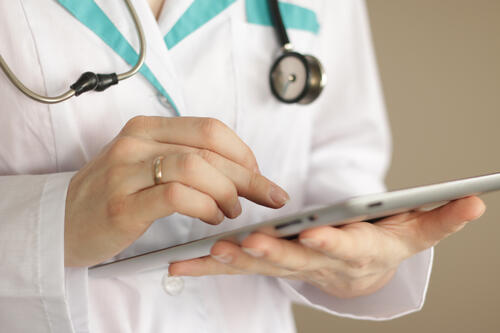 physician holding tablet